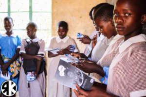 Girls of Soko receiving Sanitary Pad Kits