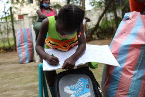 A student from Molem using her new education pack