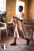 Young student at Soko receiving new school shoes