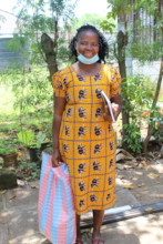 A mum from Dunga community receives a food pack