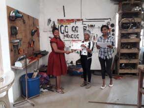 Ellie giving JTP certificates.