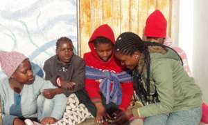 NGU student Coletha with children at TOM