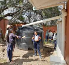 Students explain the rainwater system to visitors