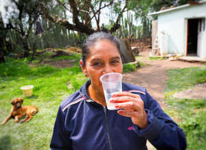 Drinking freshly filtered rainwater in Pozo Hondo