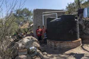 A family with their new rainwater system