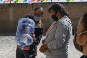 Women inspecting a new ceramic water filter