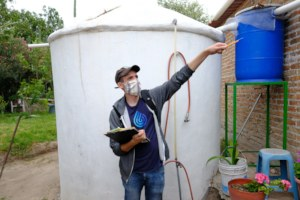 Caminos Staff Inspects a Finished Rainwater System