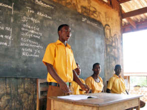 Godfred in a classroom