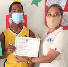 Wilmy receiving his certificate