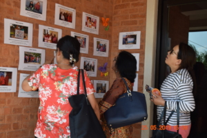 Our supporters going through the Photo Exhibition