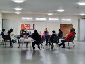Children doing circle time at the club for social