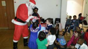 Santa giving present to children