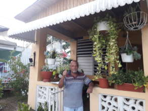 Jose in Front of His Newly Roofed Home