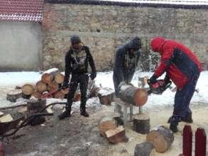 Firewood to heat a classroom in Romania