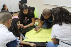 Kayan staff member facilitates workshop with youth