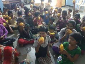 Home Children enjoying the king of fruits (Mango)
