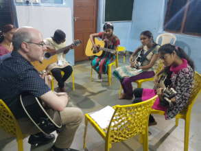 Home Children learning Music (Guitar )....