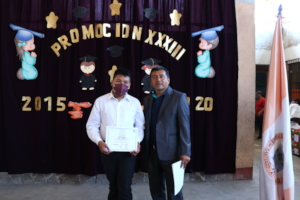 Oliver receiving his sixth grade diploma
