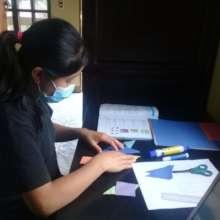 Hadasa doing her homework at Cojolya