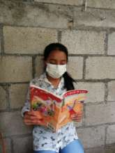 Dulce reading her favorite book