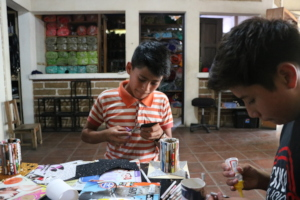 Manuel and David work on their pen holders