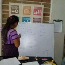 Lourdes revising Tz'utujil, her native language