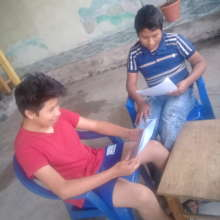 Oliver and Misael reading at home