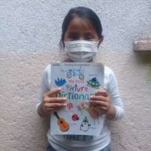 Damariz reads her book at home