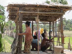 Villagers Building The Walls/Ceiling Of A Latrine