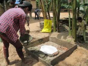 Pouring The Concrete Floor For A New Latrine