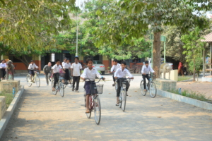 Leaving school on their new bikes