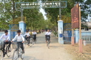 Students with their new bicycle