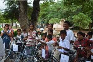Happy Students And Family Members With New Bikes