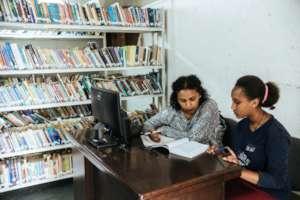 Asnaku tutoring Sinafikish with her studies