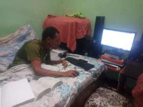 Lemma following his education using his computer