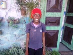 Maraki at home during social worker's visit