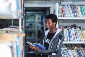 Youth accessing BHE's library with  >13,000 books