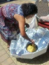 Rose cooking on solar oven