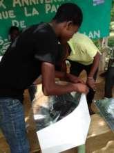 A new solar cooker at university in Hinche, Haiti