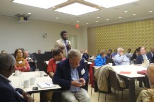 A participant raises a question