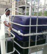 University student with biodigester at Hinche