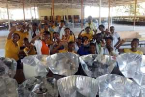 New students learning to assemble solar cookers