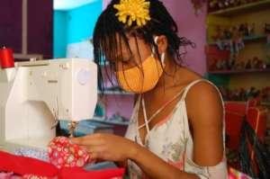 Masked girl makes masks