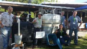 Biodigesters at ECHO with Solar CITIES & PPAF reps