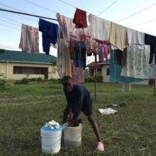 Washing the uniform at Malaika
