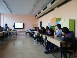 Volunteer presenting her career choice to students
