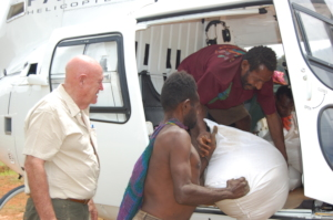 Unloading famine relief supplies from helicopter