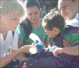 Therapist from the brigad working with child