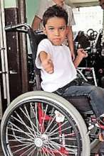 child gives thumbs up for new wheel chair