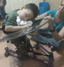 little boy falls asleep as he gets mobility aid
